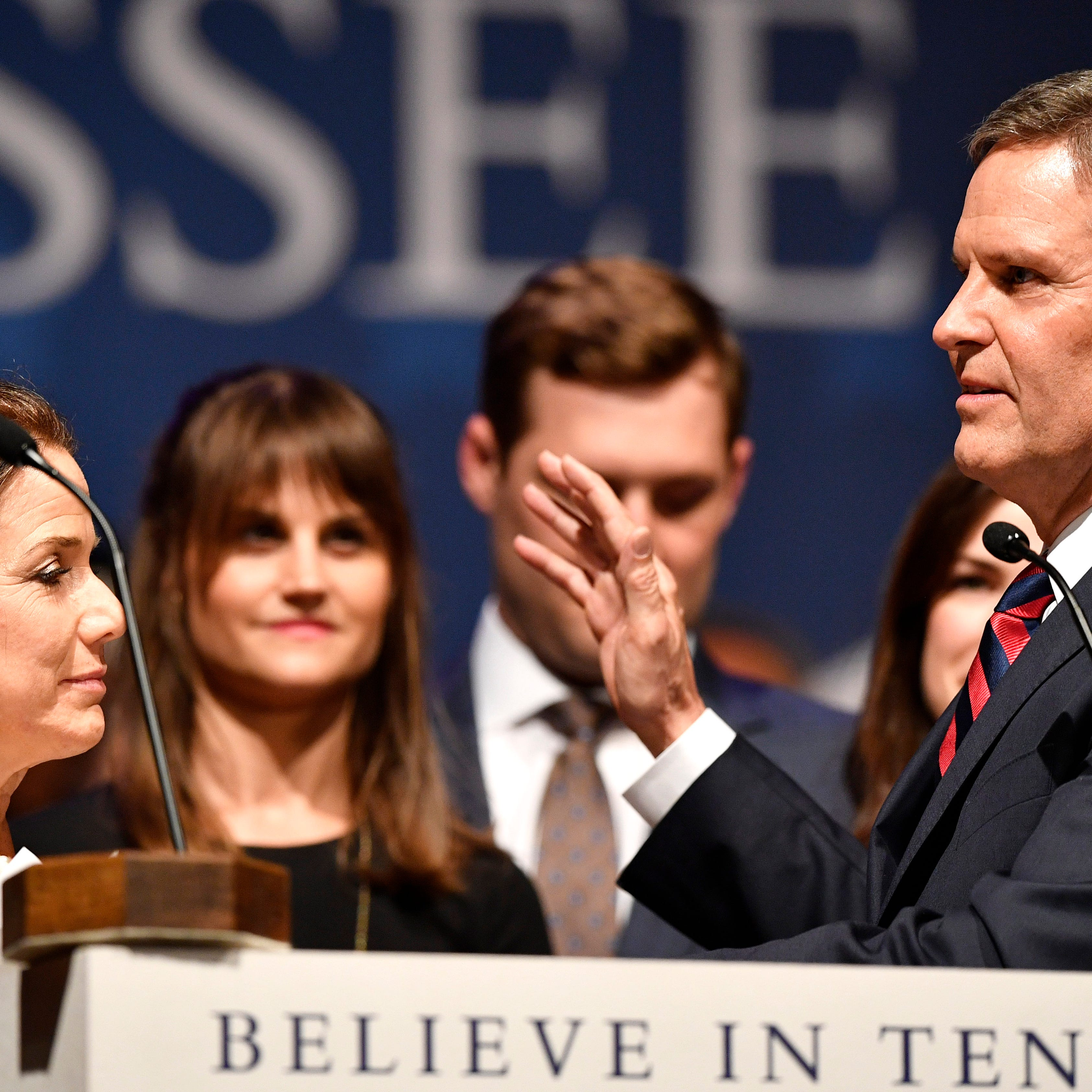 Bill Lee is sworn in as the 50th governor of Tennessee by Supreme Court Chief Justice Jeffrey Bivins as Maria Lee holds the Bible during the inauguration at War Memorial Auditorium in Nashville, Tenn., Saturday, Jan. 19, 2019.
