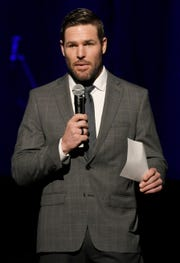 Former Predators captain Mike Fisher reads scripture at the inaugural worship service at Grand Ole Opry House in Nashville on Saturday, Jan. 19, 2019.