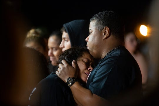 Pili Meyiza mourns her daughter Jennifer Henao and granddaughter Catalaya Henao during a candlelight vigil Friday, Jan. 18, 2019, at her home in Golden Gate Estates.