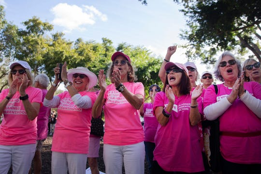 Women cheer as speeches are made during a rally for the Women's March, Saturday, Jan. 19, 2019, at Cambier Park in Naples.