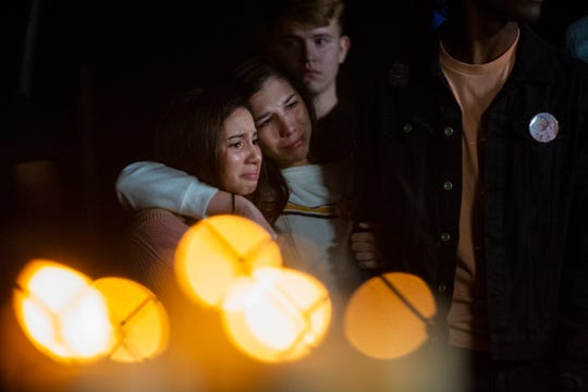 Yazhi Chang, left, and Tiffani Amaral mourn Jennifer Henao and her daughter Catalaya Henao during a vigil Friday, Jan. 18, 2019, in Golden Gate Estates.