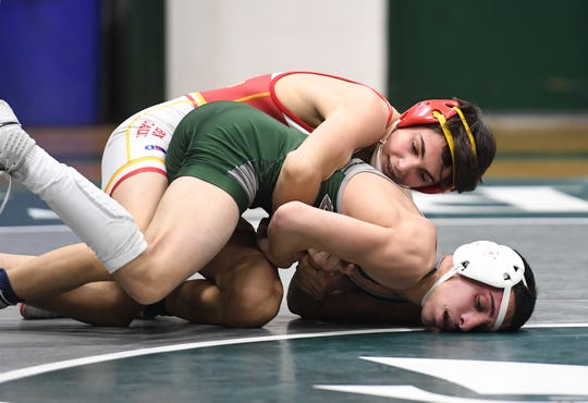 Bergen Catholic wrestling at DePaul in Wayne on Friday, January 18, 2019. BC Joseph Cangro on his way to defeating DP Eric Checinski in their 106 pound match.