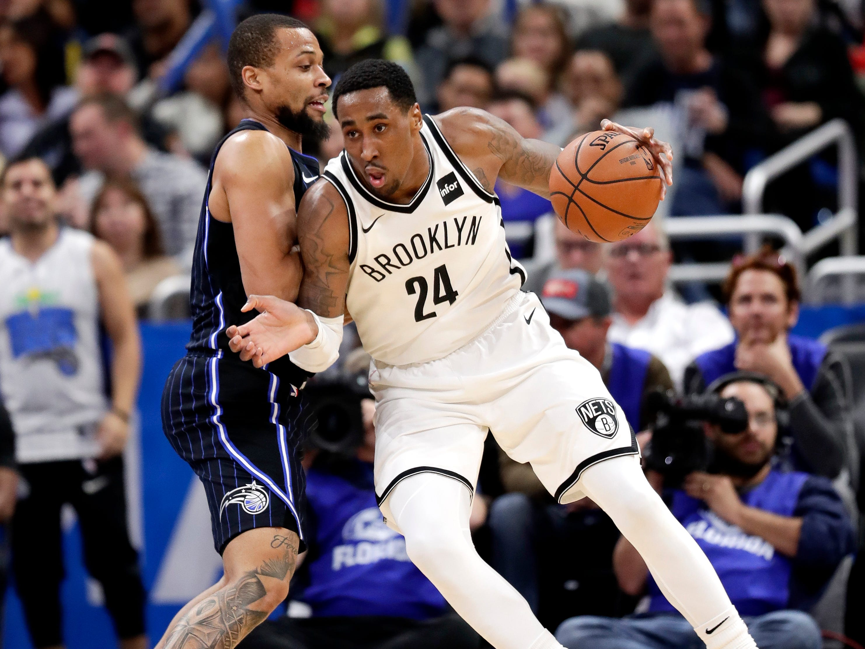 Brooklyn Nets' Rondae Hollis-Jefferson (24) moves to the basket as Orlando Magic's Isaiah Briscoe defends during the first half of an NBA basketball game Friday, Jan. 18, 2019, in Orlando, Fla.