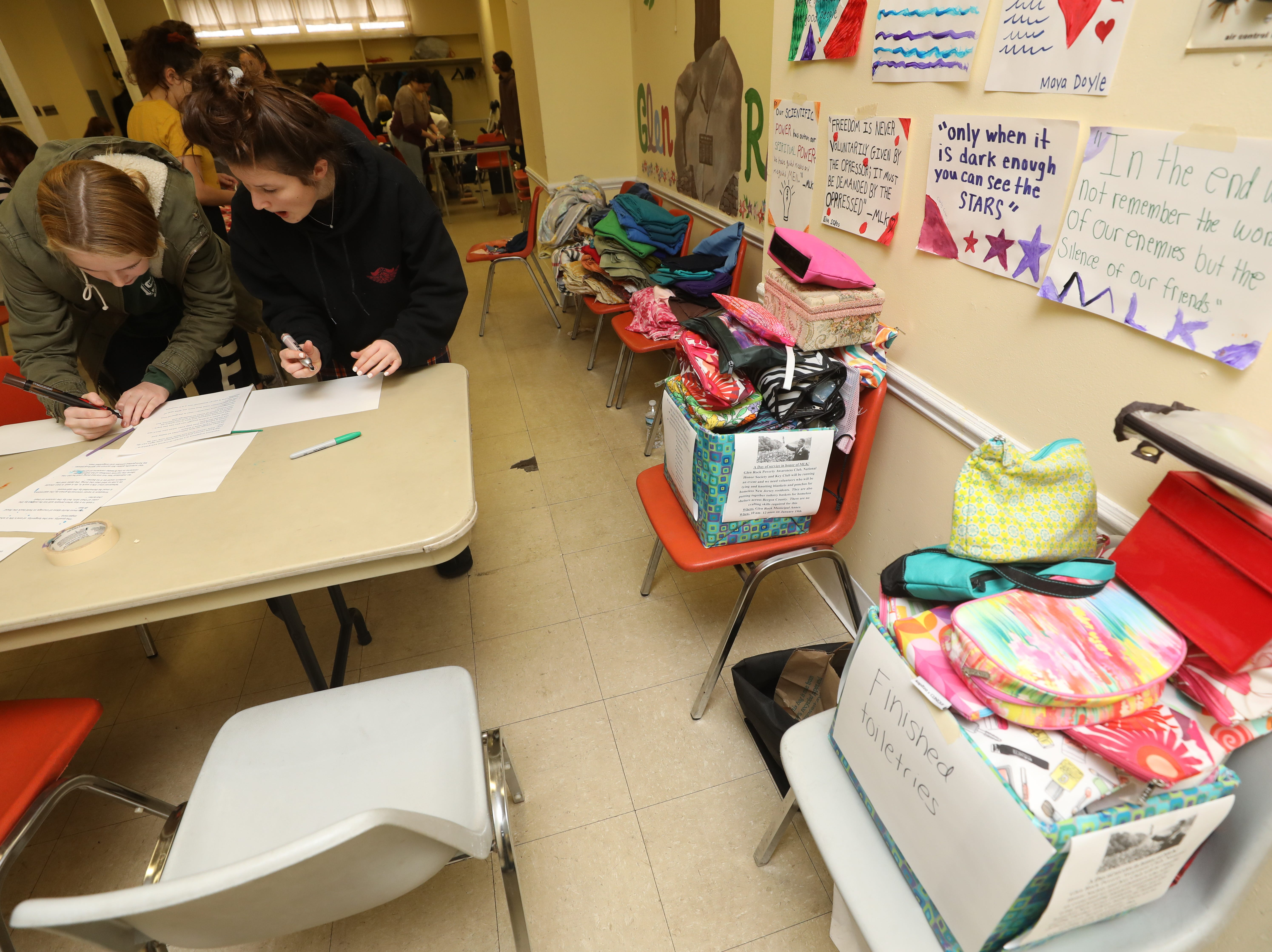 Quotes from Dr. Martin Luther King, cloth items such as toiletry cases are part of a Day of Service at the Glen Rock Annex on January 19, 2019 in recognition of Martin Luther King Day.