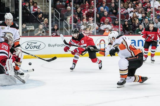 Jan 19, 2019; Newark, NJ, USA; Anaheim Ducks right wing Daniel Sprong (11) scores goal past New Jersey Devils goaltender Mackenzie Blackwood (29) as defenseman Will Butcher (8) defends during the first period at Prudential Center.