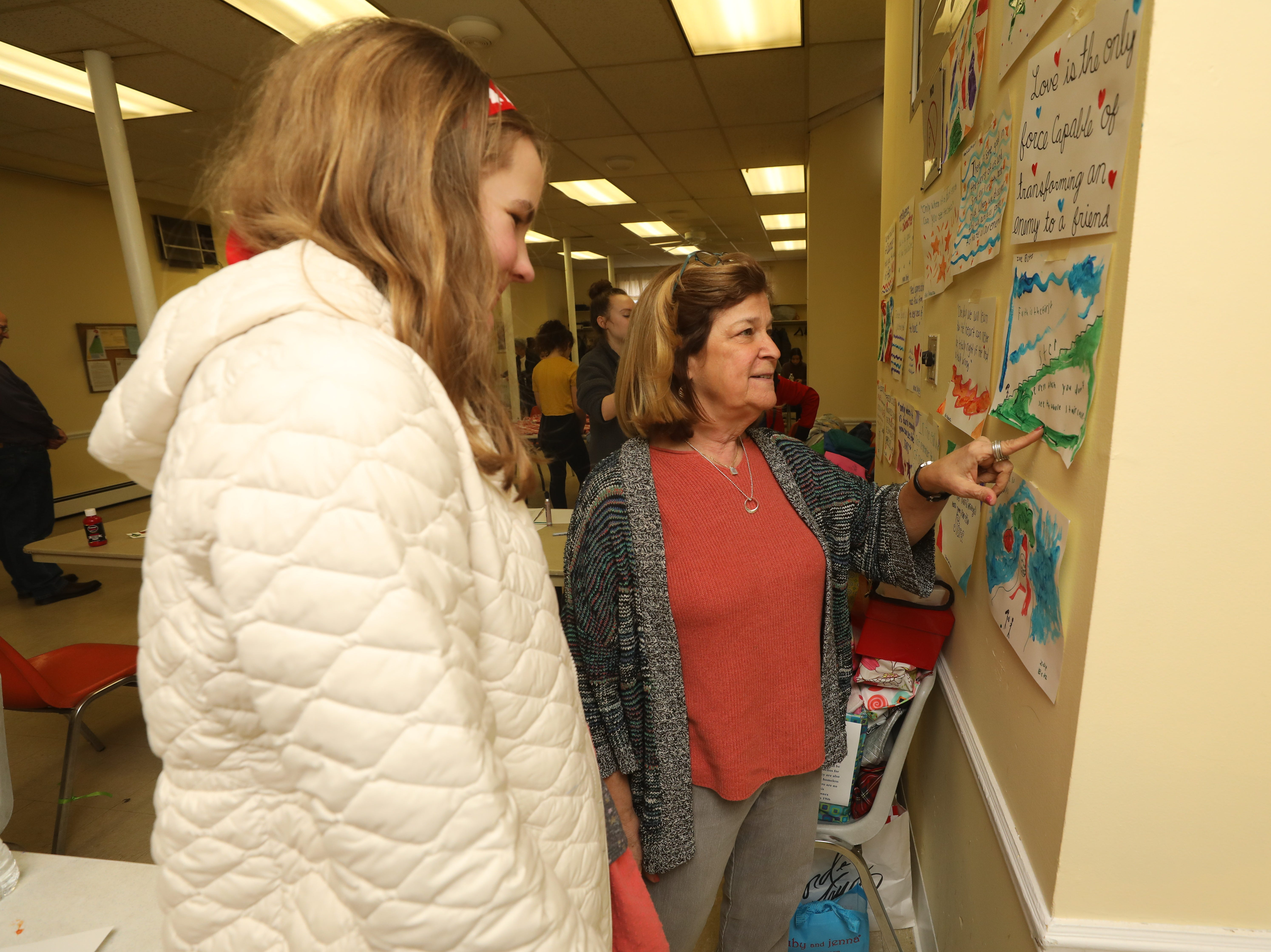 Zoe Betz 12 and Roann Rubin, a member of the Glen Rock/Ridgewood MLK Committee look at quotes from Dr. Martin Luther King, drawn and posted by those who attended a Day of Service at the Glen Rock Annex on January 19, 2019 in recognition of Martin Luther King Day.
