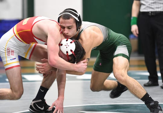 Bergen Catholic wrestling at DePaul in Wayne on Friday, January 18, 2019. DP Nicky Cabanillas on his way to defeating BC Patrick Gray in their 126 pound match.