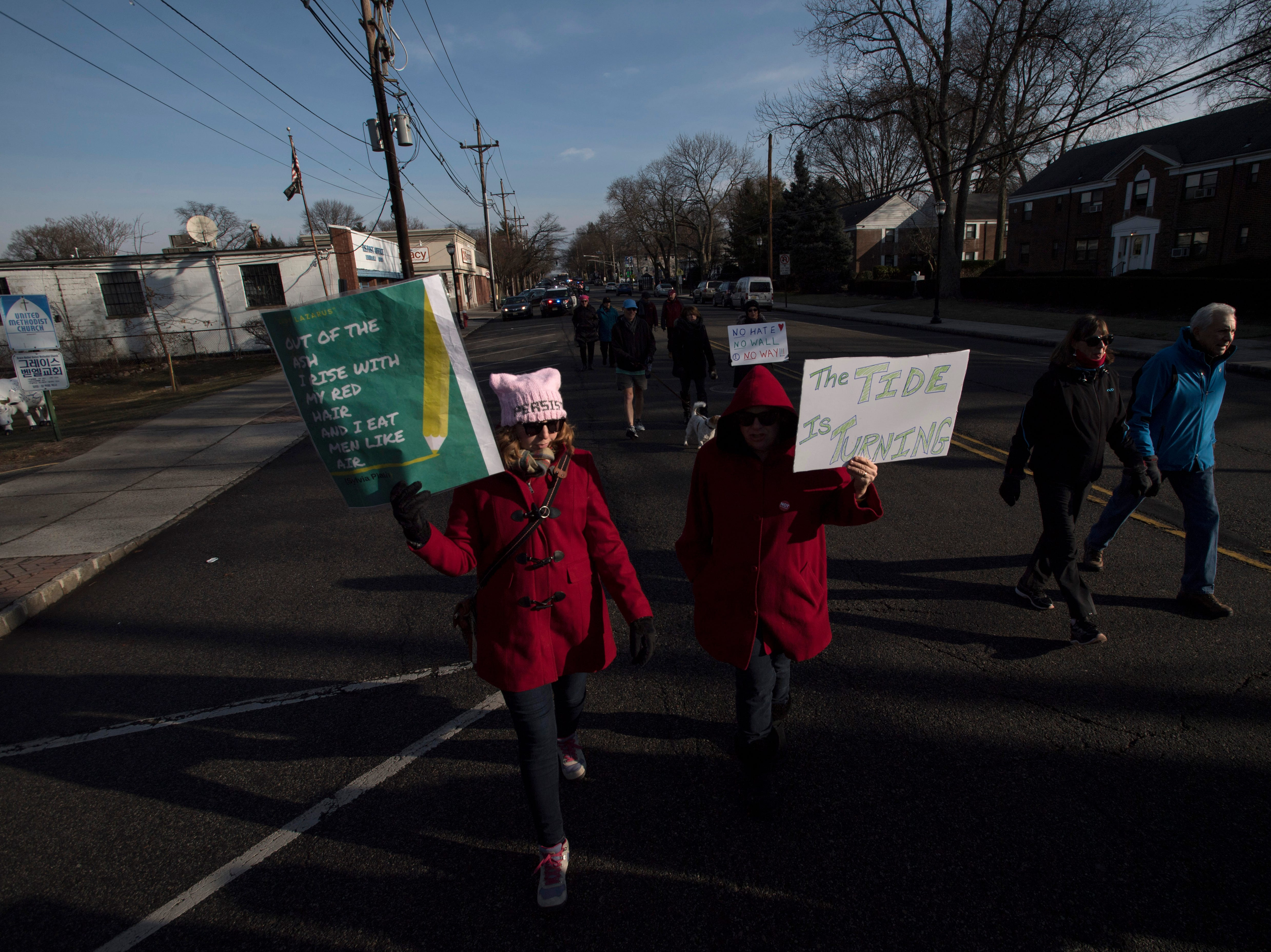 (left) Elizabeth Lefford and Jean Sagredo march on Broad Avenue in Leonia during the Leonia Women's March on Saturday, January 19, 2019.