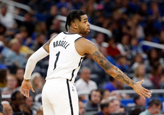 Jan 18, 2019; Orlando, FL, USA; Brooklyn Nets guard D'Angelo Russell (1) high fives as he makes a three pointer against the Orlando Magic during the second quarter at Amway Center.
