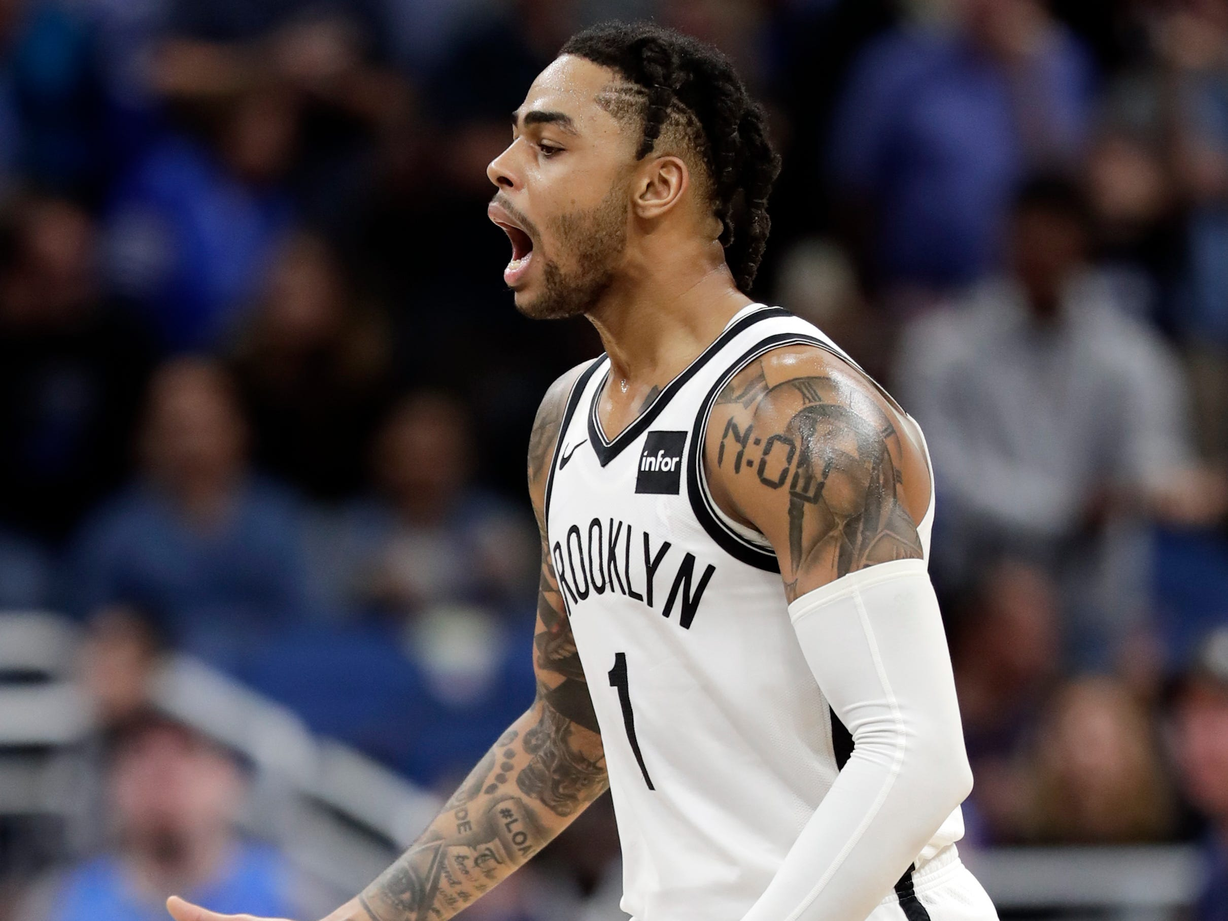 Brooklyn Nets' D'Angelo Russell celebrates after making a 3-point shot during the final moments of the team's NBA basketball game against the Orlando Magic, Friday, Jan. 18, 2019, in Orlando, Fla.