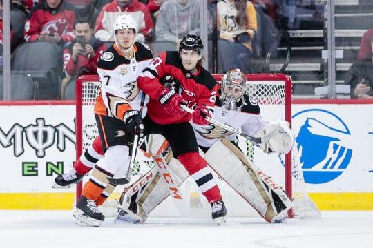 Jan 19, 2019; Newark, NJ, USA; New Jersey Devils center Blake Coleman (20) screens Anaheim Ducks goaltender John Gibson (36) as left wing Rickard Rakell (67) defends during the first period at Prudential Center.