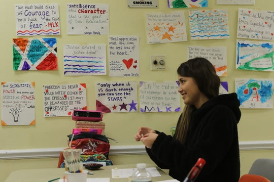 Key Club board member Maya Doyle works on quotes from Dr. Martin Luther King, that were drawn and posted by those who attended a Day of Service at the Glen Rock Annex on January 19, 2019 in recognition of Martin Luther King Day.