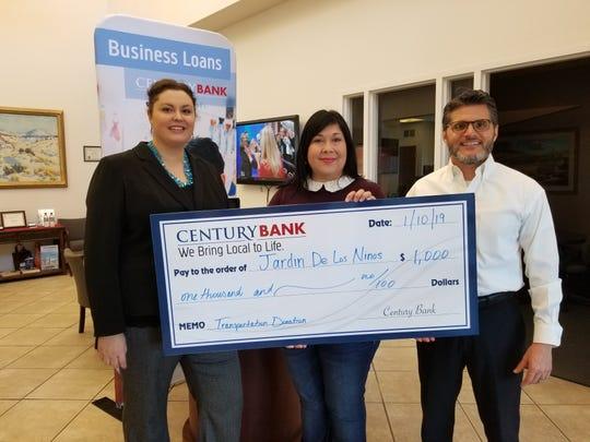 Erica Saunders and Gerardo Valencia from Century Bank Las Cruces branch presented a donation to Jardin De Los Niños.