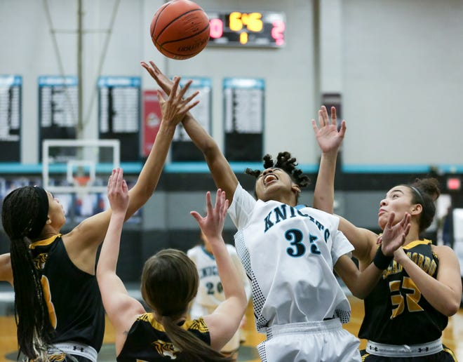 Oñate High School's Sydney Hobbs grabs a rebound between three Alamogordo High School basketball players on Friday Jan. 18, 2019 at OHS.