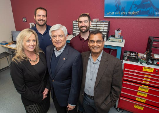 Chancellor Dan Arvizu, center, his wife, Sheryl Arvizu,left front row Dean of Engineering Lakshmi Reddi,right front row, Taylor Fresques, right back row, Manufacturing Tech and Engineering Center lab coordinator and Luke Nogales, left back row, Engineering Technology associate professor, in the Aggie Innovation Space, In the Ed and Foreman Engineering Complex III, Thursday January 10, 2018. The chancellor and Mrs. Arvizu gave a gift of $250,000 to support student scholarships and fellowships in the Aggie Innovation Center.