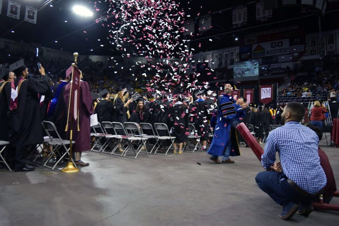 An innovator atNewMexicoStateUniversity's Aggie Innovation Spacefiresaconfetti cannon at commencement ceremonies at the Pan American Center.Fivedevices were built in spring 2017andfirst used during the May 2017 commencement ceremonies at NMSU.