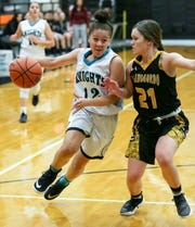 Oñate High School's Angel Jones tries to get past her Alamogordo High School opponent Calysta Jacob on Friday Jan. 18, 2019 at OHS.