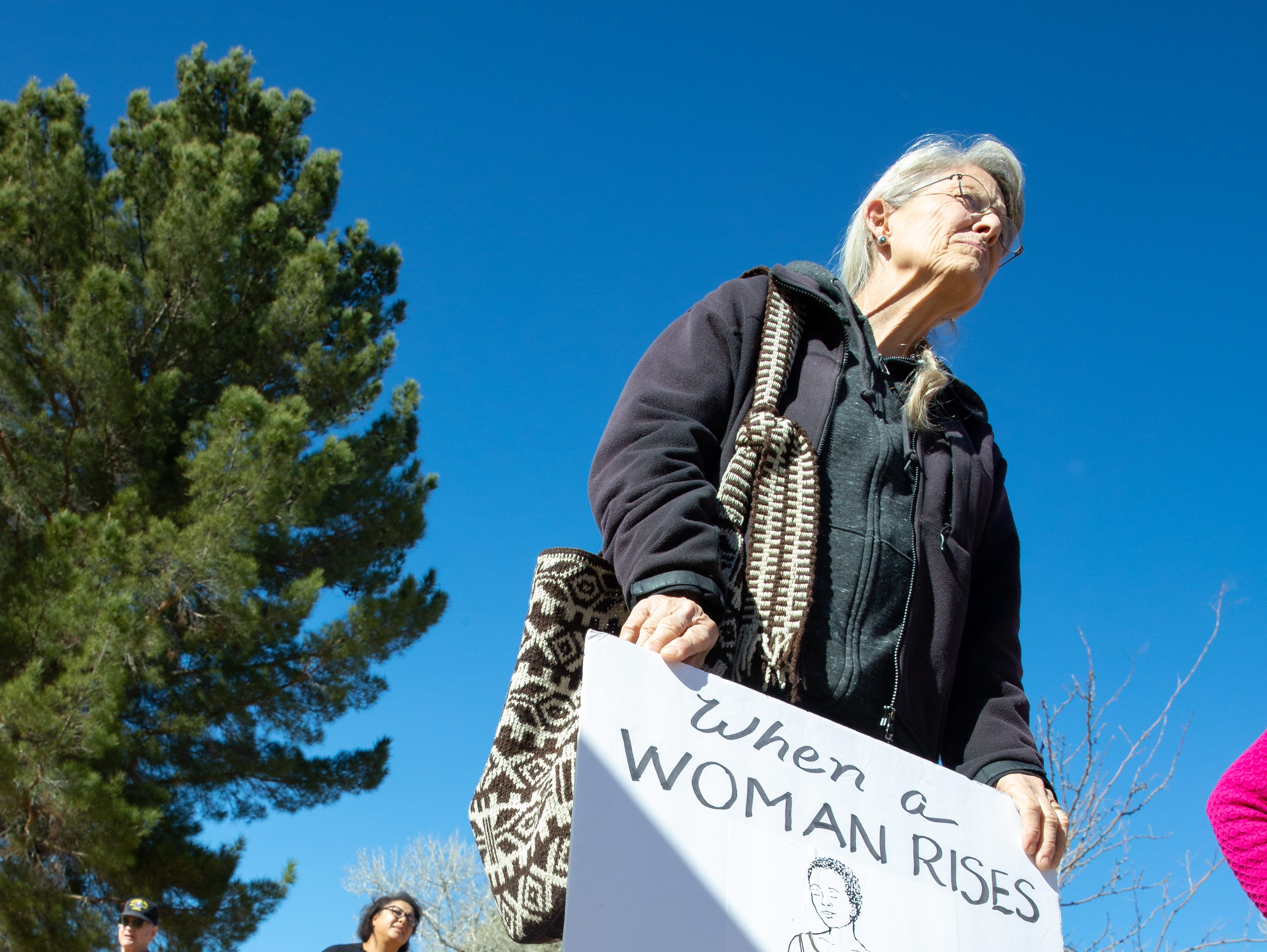 Women and men bring signs to the 2019 Las Cruces Women's Rally on Saturday, January 19, 2019 at Albert Johnson Park.