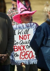 "Juliana Durrett is pictured with a sign that reads, ""I will not go quiety back to the 1950s,"" on Saturday, January 19, 2019 at Albert Johnson Park during the 2019 Las Cruces Woman's Rally."