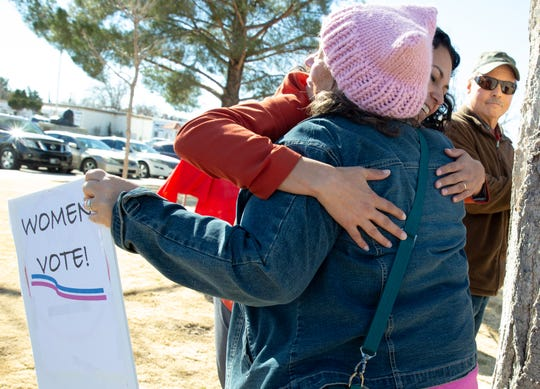 While holding a sign about women voting, Kathy Meyer gives U.S. House Rep. Xochitl Torres Small a hug on Saturday, January 19, 2019 at Albert Johnson Park during the 2019 Las Cruces Woman's Rally.