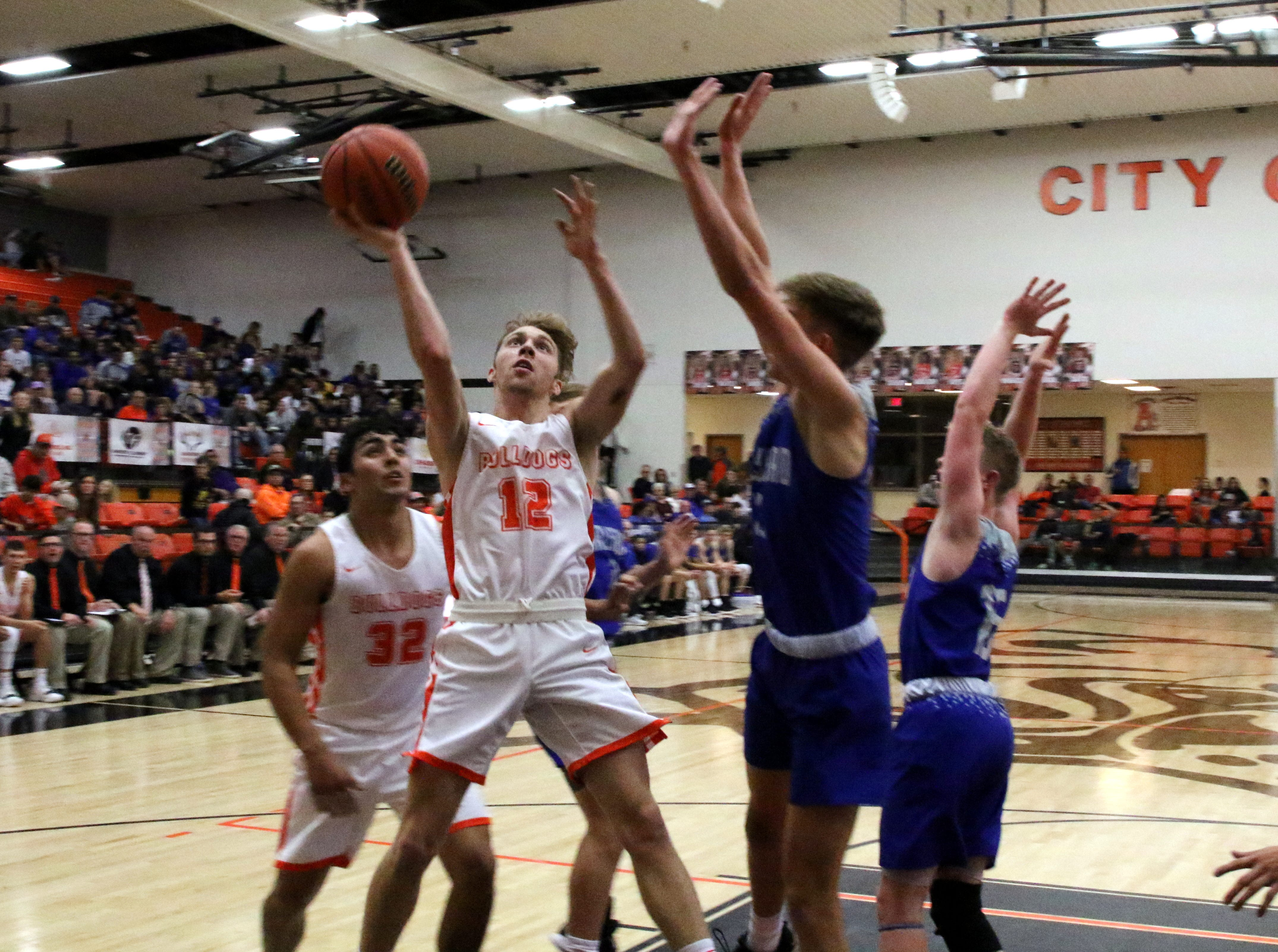Artesia's Luke Nelson (12) gets off a shot during Friday's game against Carlsbad. Nelson finished with four points.