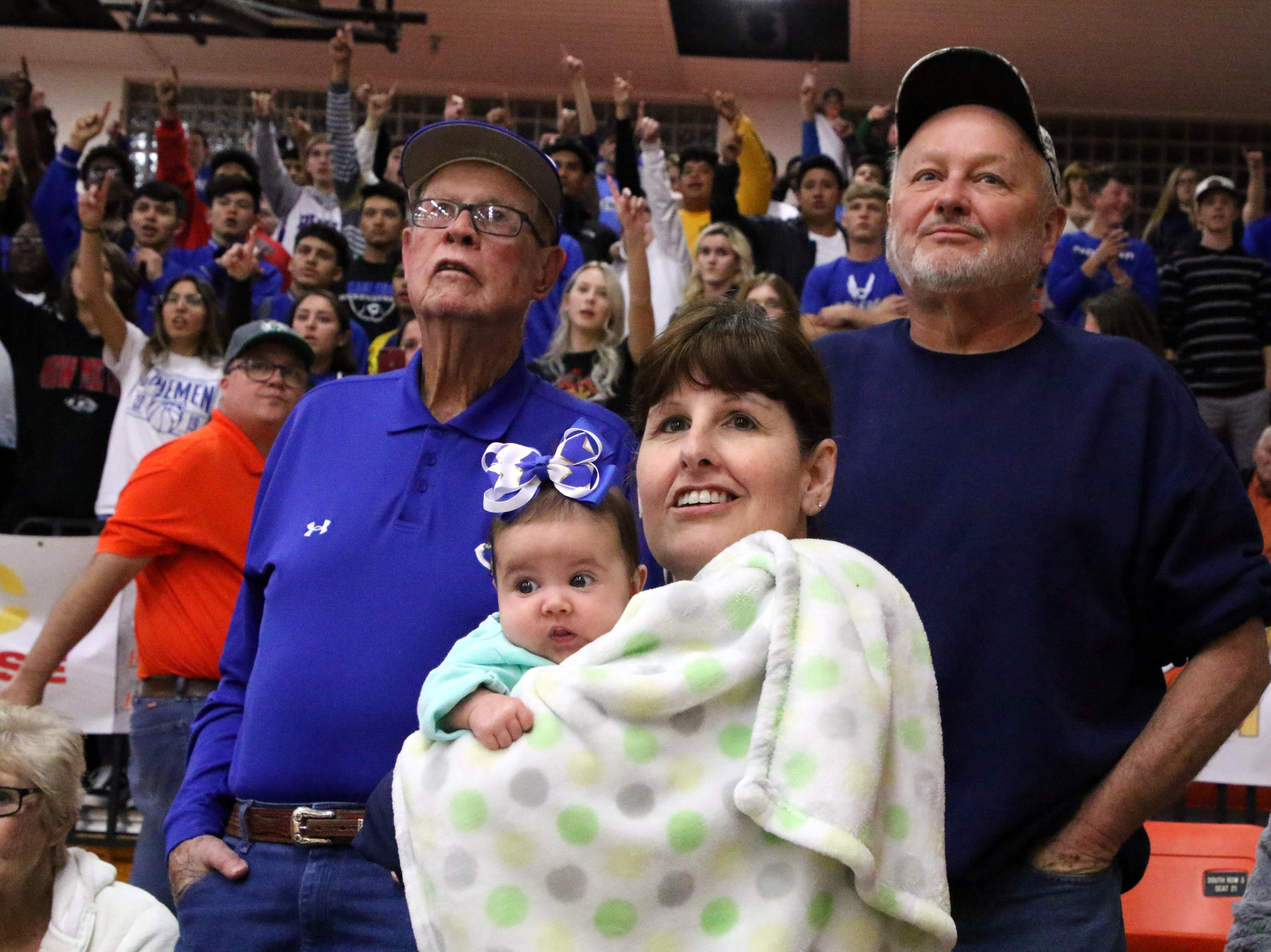 A young Caveman fan and her mother watch the final seconds of Friday's game against Artesia. Carlsbad swept the season series with a 59-56 win.