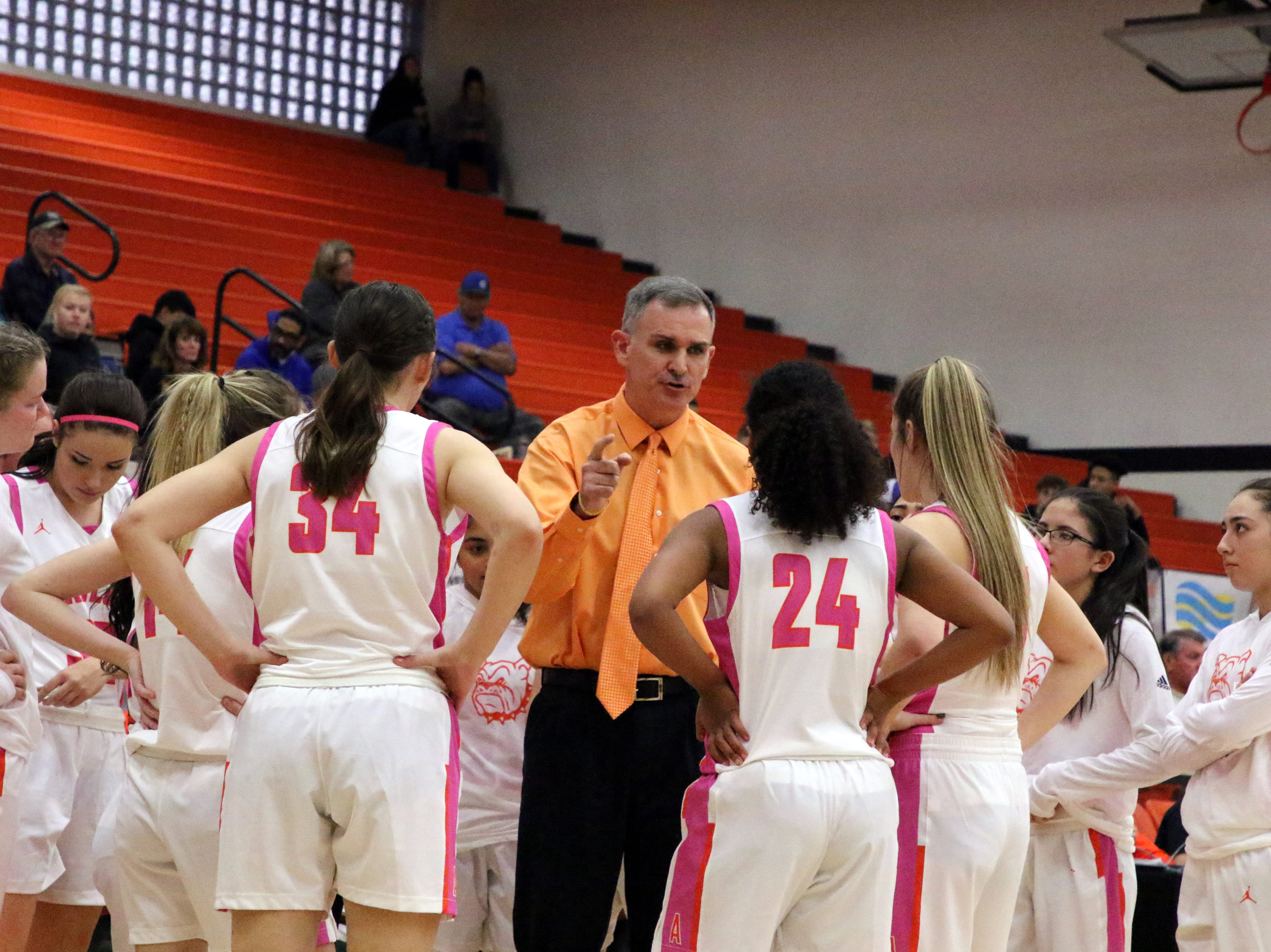Artesia coach Jeff Houghtaling talks to his team during a first quarter timeout in Friday's game against Carlsbad.