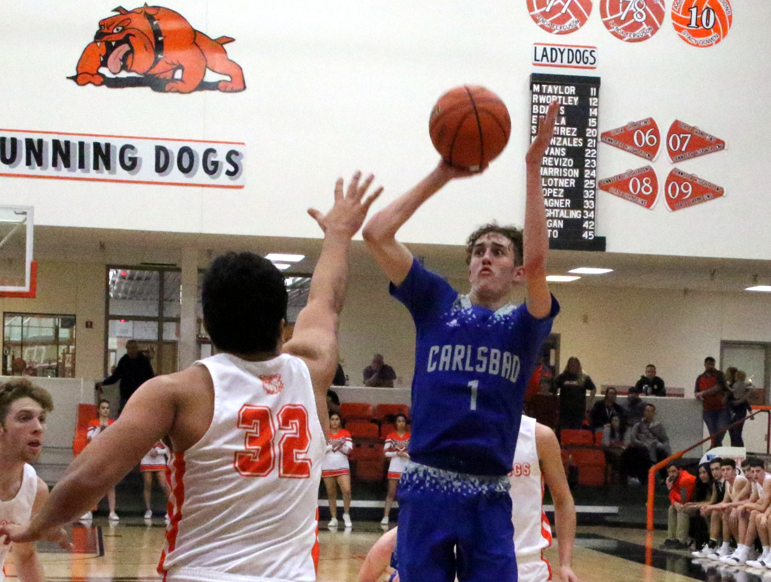 Josh Sillas takes a jump shot during Friday's game. Carlsbad swept the season series with a 59-56 win.