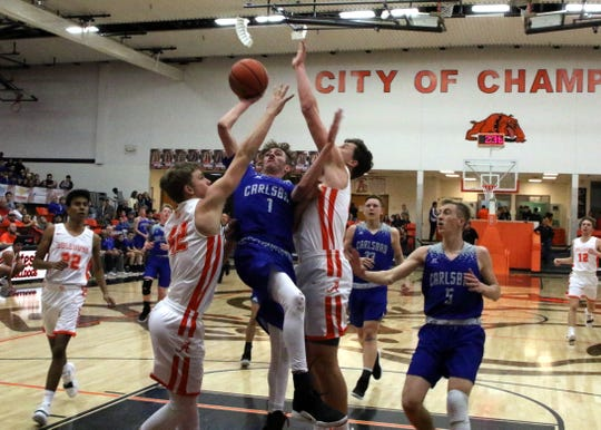 Carlsbad's Josh Sillas (1) is fouled while attempting a layup in the first half of Friday's game against Artesia. Sillas finished with 33 points, allowing Carlsbad to sweep the season series with a 59-56 win.