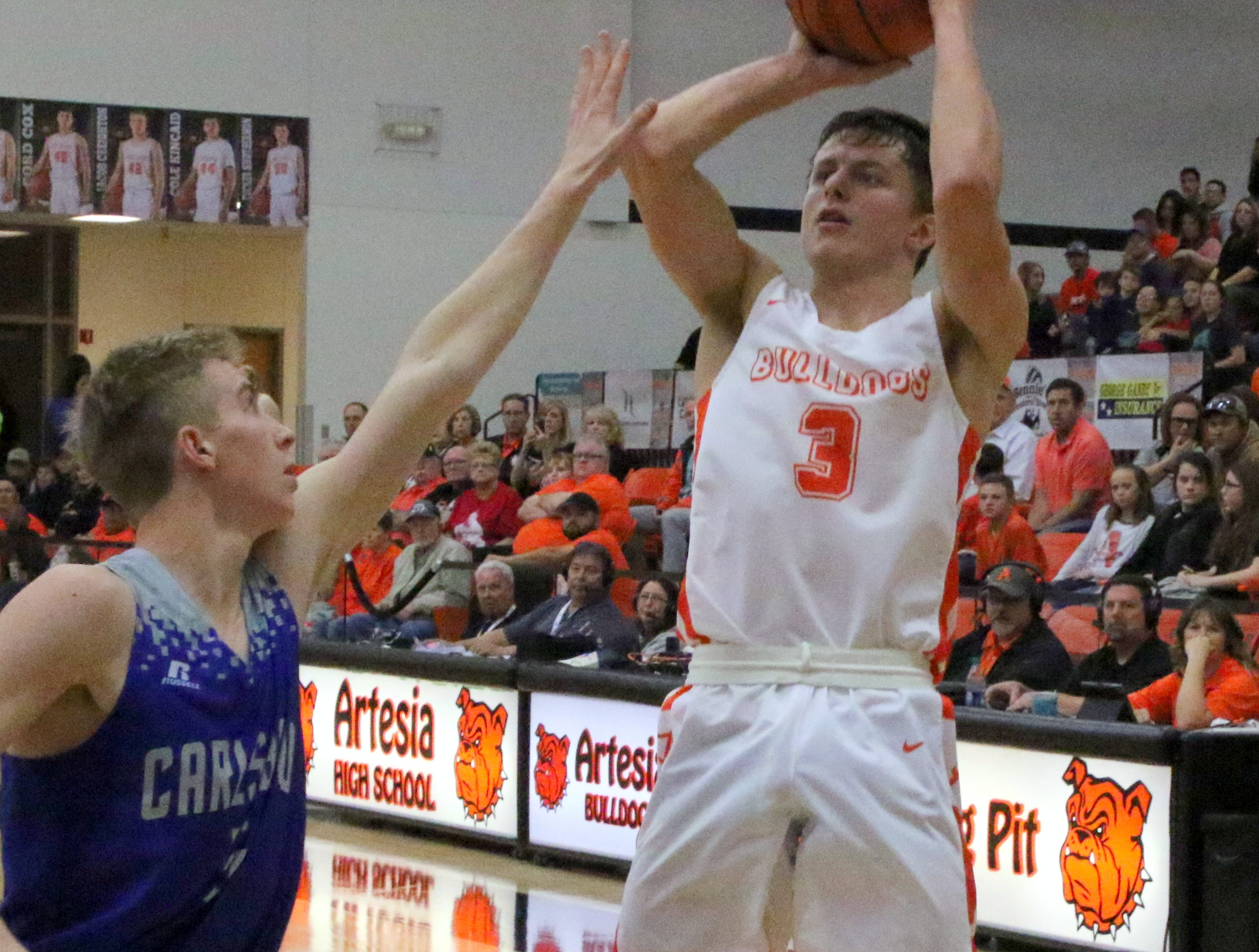 Artesia's Cody Smith takes a jump shot during Friday's game against Carlsbad. Smith finished with 10 points.