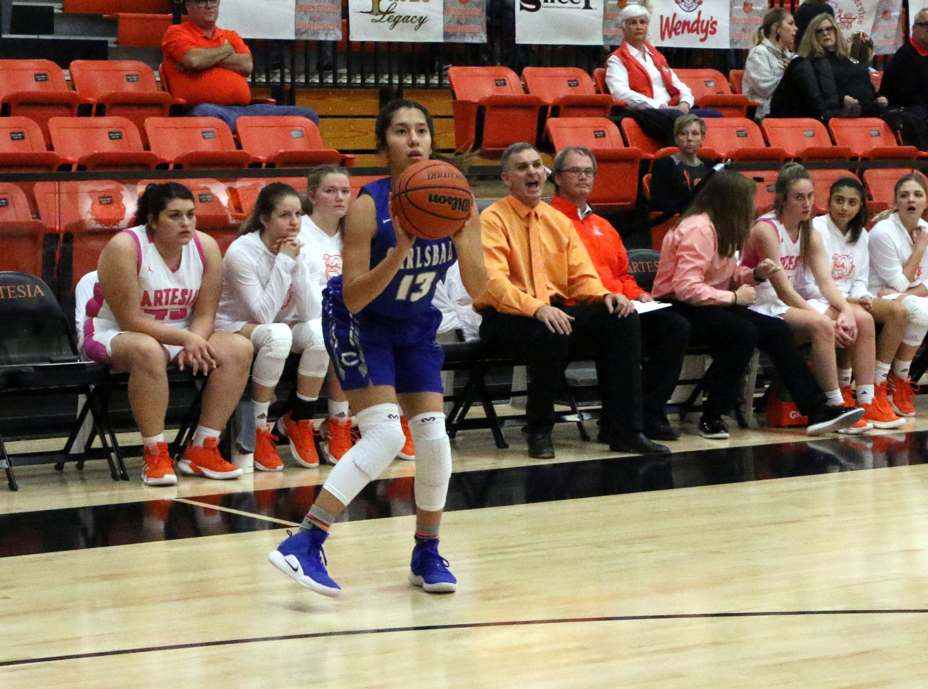 Carlsbad's Tori Flores loads up for a 3-point shot during Friday's game against Artesia. Flores finished with four points in the win.