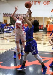 Artesia's Paityn Houghtaling (34) and Carlsbad's Destiny Young fight for a rebound during Friday's game. Carlsbad swept the season series with a 58-35 win.
