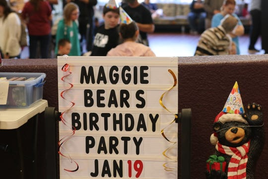 Children and their parents partake in the festivities during Maggie the bear's 14th birthday, Jan. 19, 2018 at Living Desert Zoo and Gardens State Park.