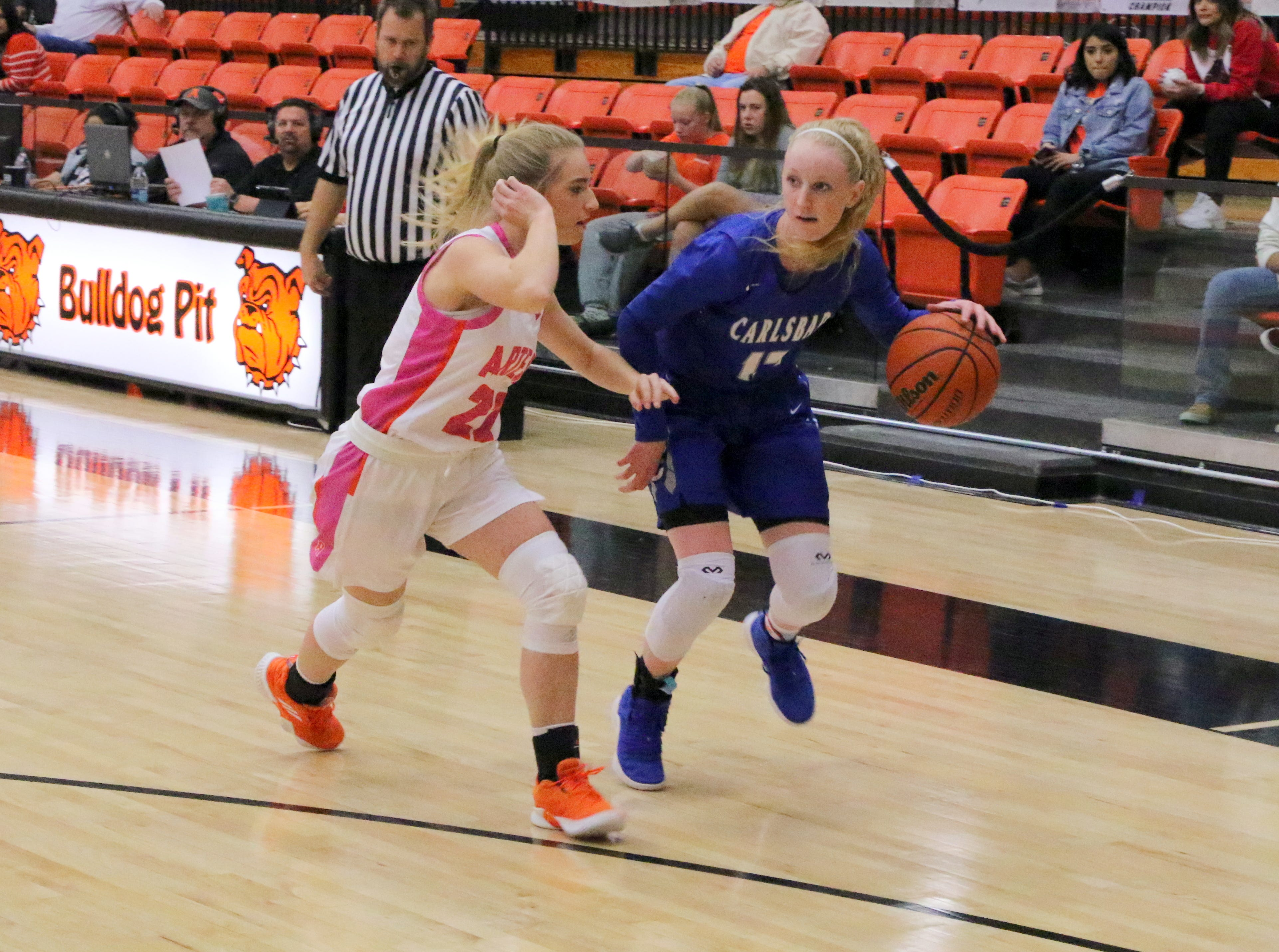 Carlsbad's Carsyn Boswell drives the lane during Friday's game against Artesia. Boswell led all scorers with 25 points.