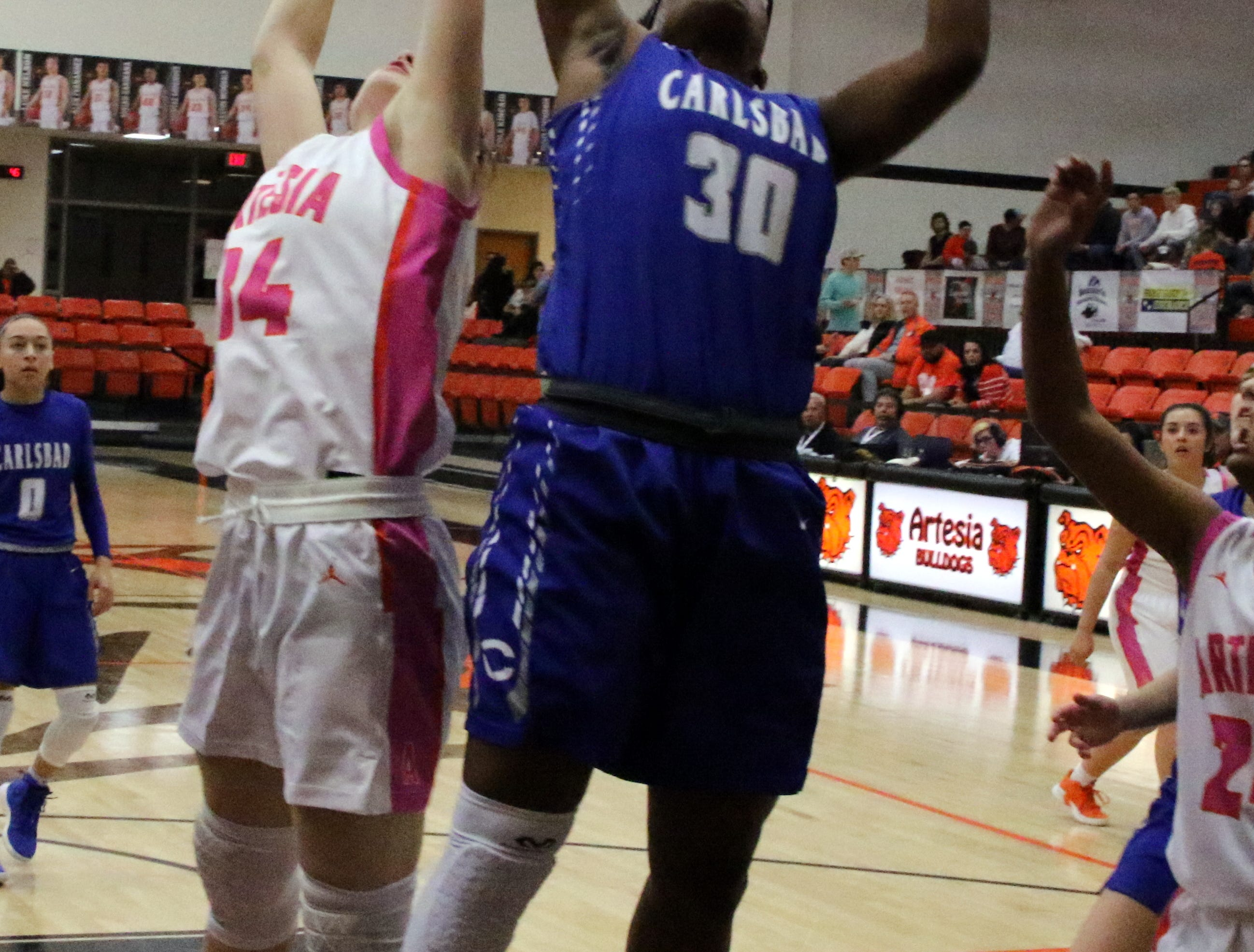 Carlsbad's Dayshaun Moore (30) pulls down a rebound during Friday's game. Moore finished with five rebounds in the game.