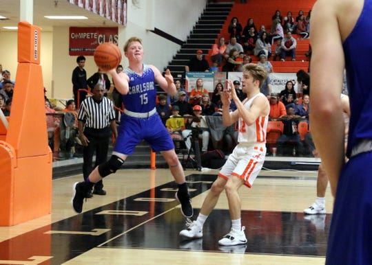Carlsbad's Andrew Miller saves a ball from going out of bounds against Artesia on Jan. 18.