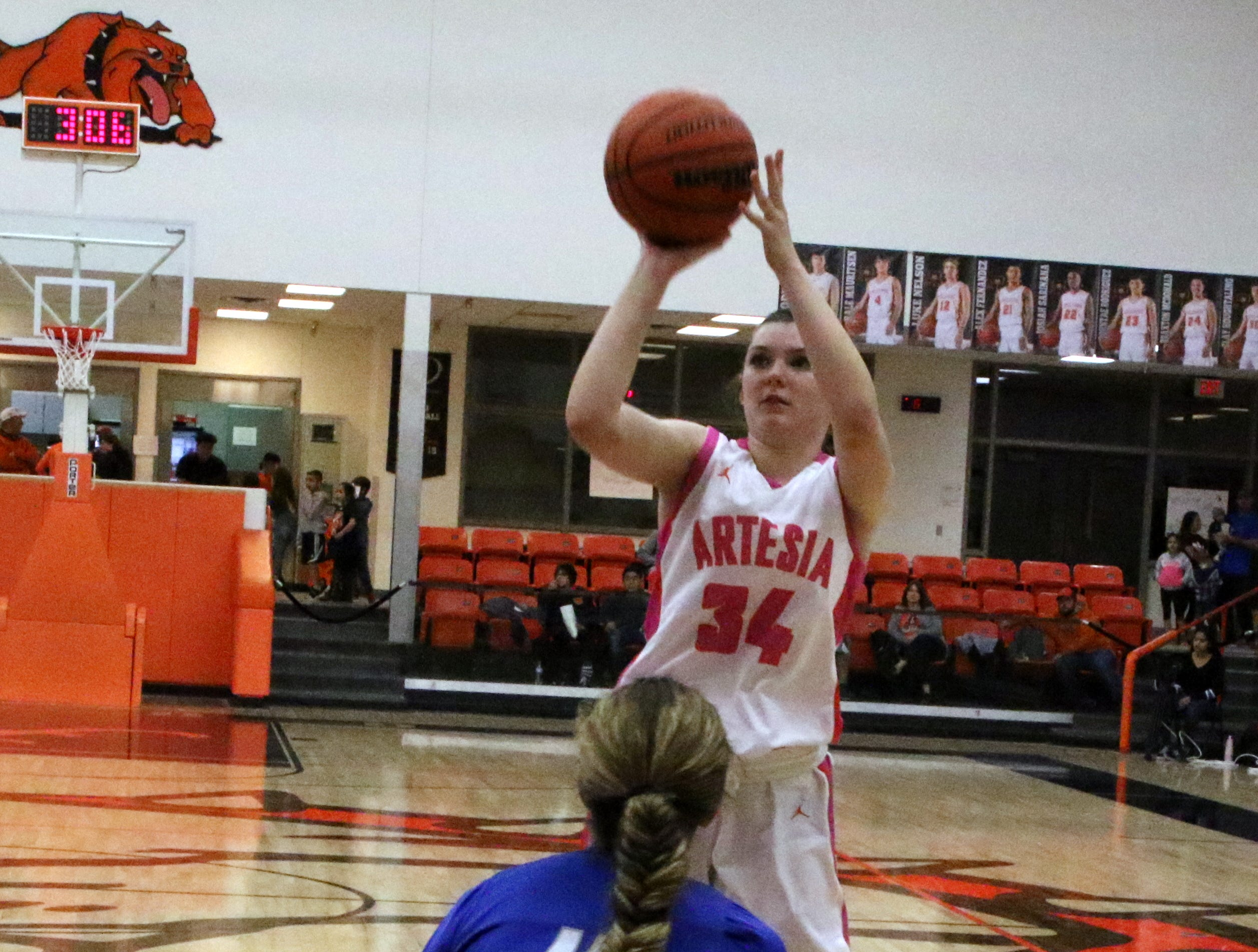 Artesia's Paityn Houghtaling takes a jump shot during Friday's game against Carlsbad. Houghtaling finished with nine points.