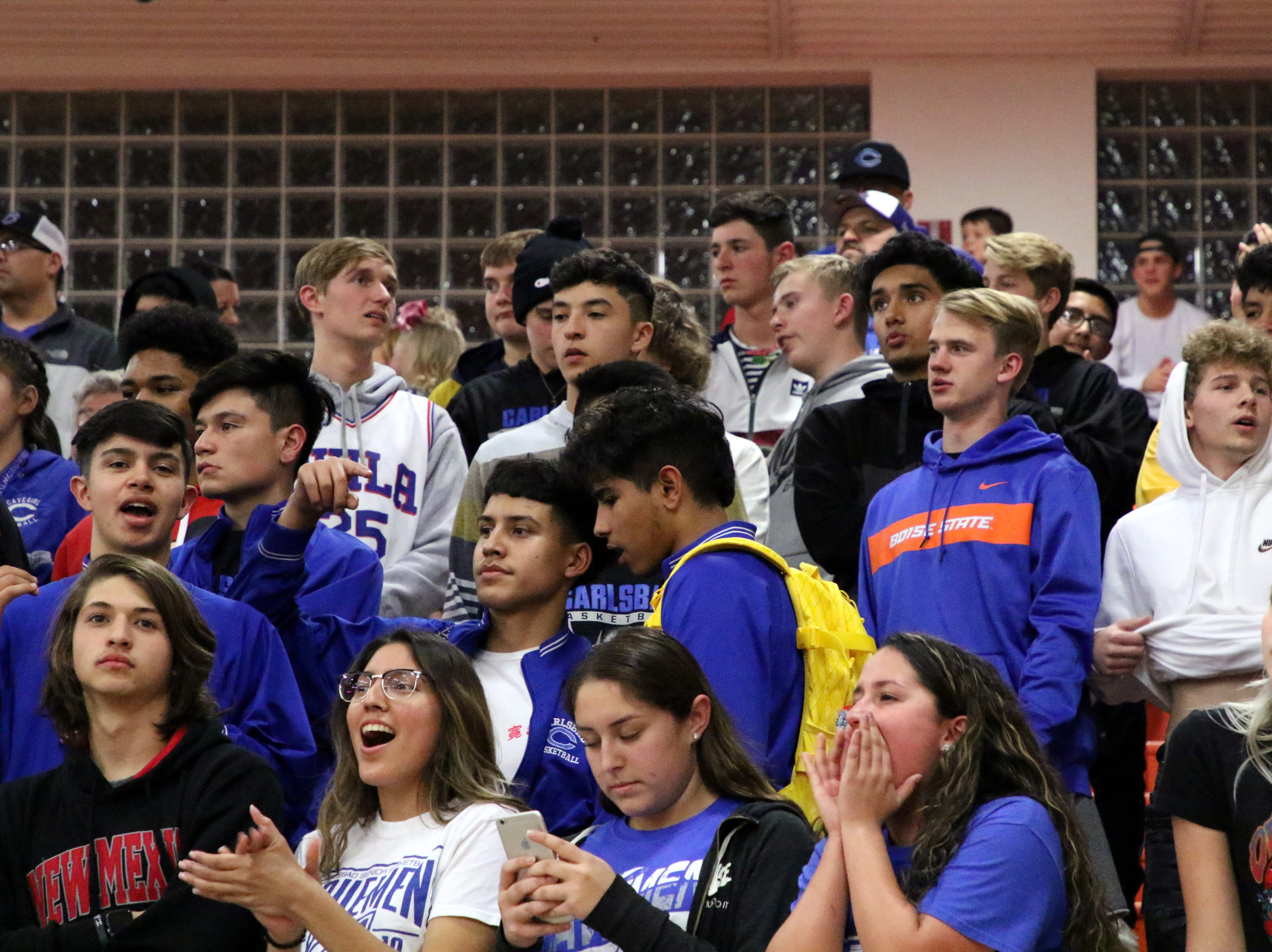 Carlsbad fans watch during Friday's game. Carlsbad swept the season series with a 59-56 win.