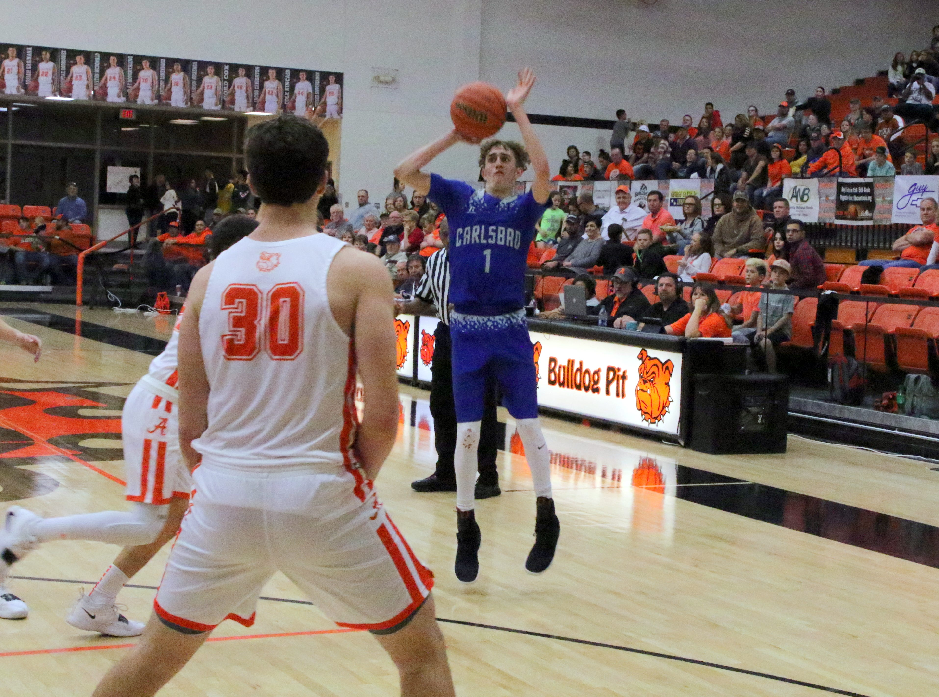 Josh Sillas shoots a 3-pointer in the first quarter of Friday's game against Artesia. Sillas made eight 3-pointers in the game to set a new single-season school record for most made triples. He currently has 59. Carlsbad swept the season series with a 59-56 win.