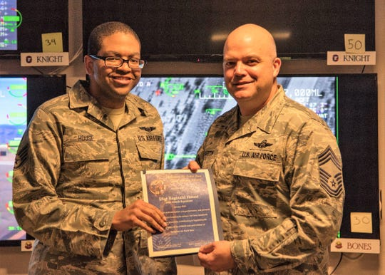 Staff Sgt. Reginald House, Remotely Piloted Aircraft sensor operator instructor, receives the Chief's Choice Award from Chief Master Sgt. Rick Marston, 49th Operations Group superintendent, Jan. 17, 2019, on Holloman Air Force Base, N.M. Holloman's Chiefs Group has a monthly recognition program titled Chief's Choice Award. Every month, a chief has the honor of choosing a deserving Airman for an outstanding act or for continuous outstanding performance.
