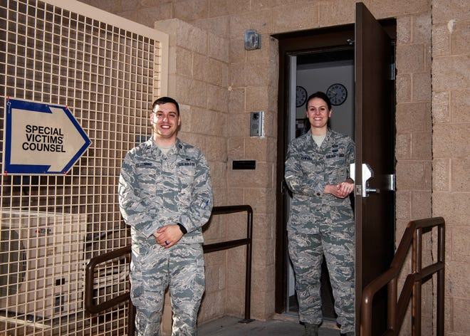 Capt. Matthew Pellegrine, 49th Wing special victims' counsel, and Tech. Sgt. Rochelle Schwarz, 49th Wing special victims' paralegal, pose outside the new Special Victims' Counsel Office, Jan. 1, 2019, on Holloman Air Force Base, N.M. The SVC offers confidential legal advice to victims of an offense under the Uniform Code of Military Justice.
