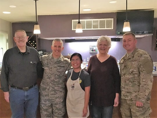 Airman 1st Class Femke Vargas, Refuel Cafe volunteer, was coined for excellent wingmanship, Oct. 5, 2018, at the Refuel Cafe on Holloman Air Force Base, N.M. Through making handcrafted beverages at her new home away from home, Vargas found her stride, improving the morale of other Airmen and developing leadership skills.