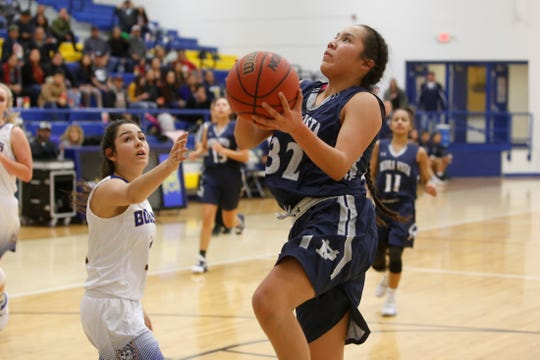 Piedra Vista's Lanae Billy drives to the basket for a layup against Bloomfield on Tuesday, Jan. 15 at Bobcat Gym. PV and Bloomfield both open district play on Tuesday night.