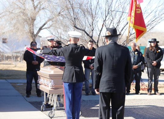 Members of the U.S. Marine Corps prepare to fold a flag during the funeral service for Navajo Code Talker Alfred K. Newman Sr. on Saturday in Farmington.