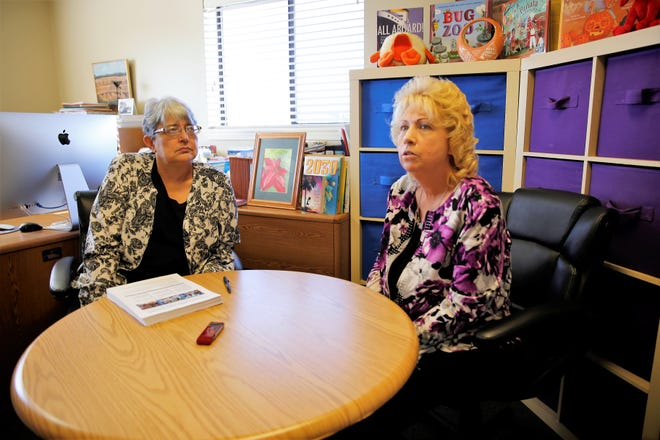 Three Rivers Education Foundation coach Pat Martinez-Lopez, left, and program coordinator Bobbie Zemanek-White talk in their Farmington office about a new $5 million federal grant to recruit teachers to a handful of districts across the state.