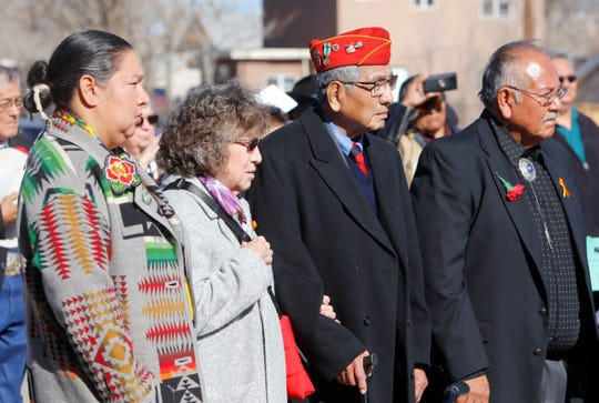 From left, Navajo Nation Council Delegate Amber Kanazbah Crotty, Wanda MacDonald, Navajo Code Talker Peter MacDonald Sr. and Marvin Newman watch the flag-folding ceremony.