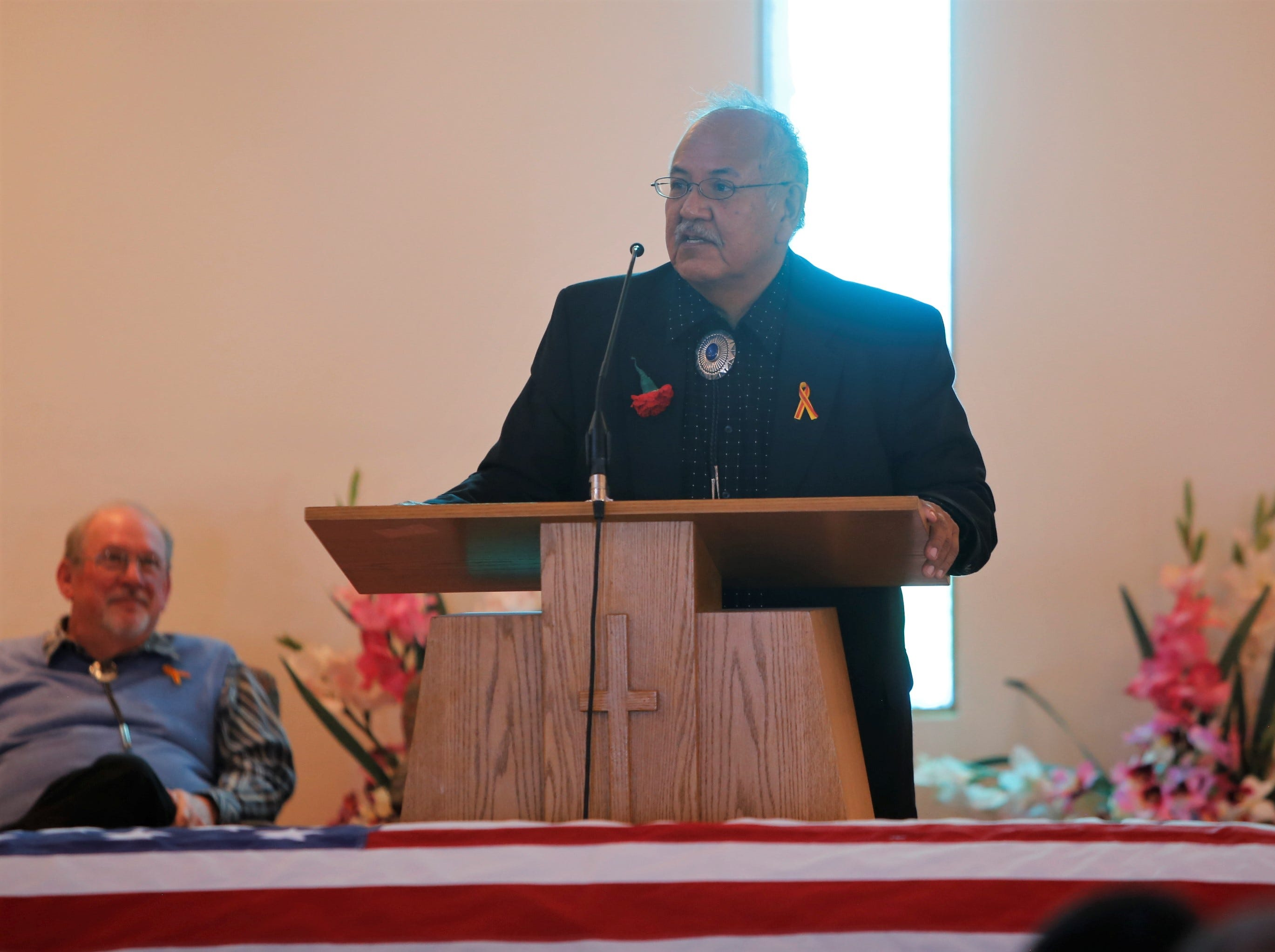 Marvin Newman delivers the eulogy during the funeral service for his father, Navajo Code Talker Alfred K. Newman Sr., on Saturday at the Maranatha Fellowship Christian Reformed Church in Farmington.
