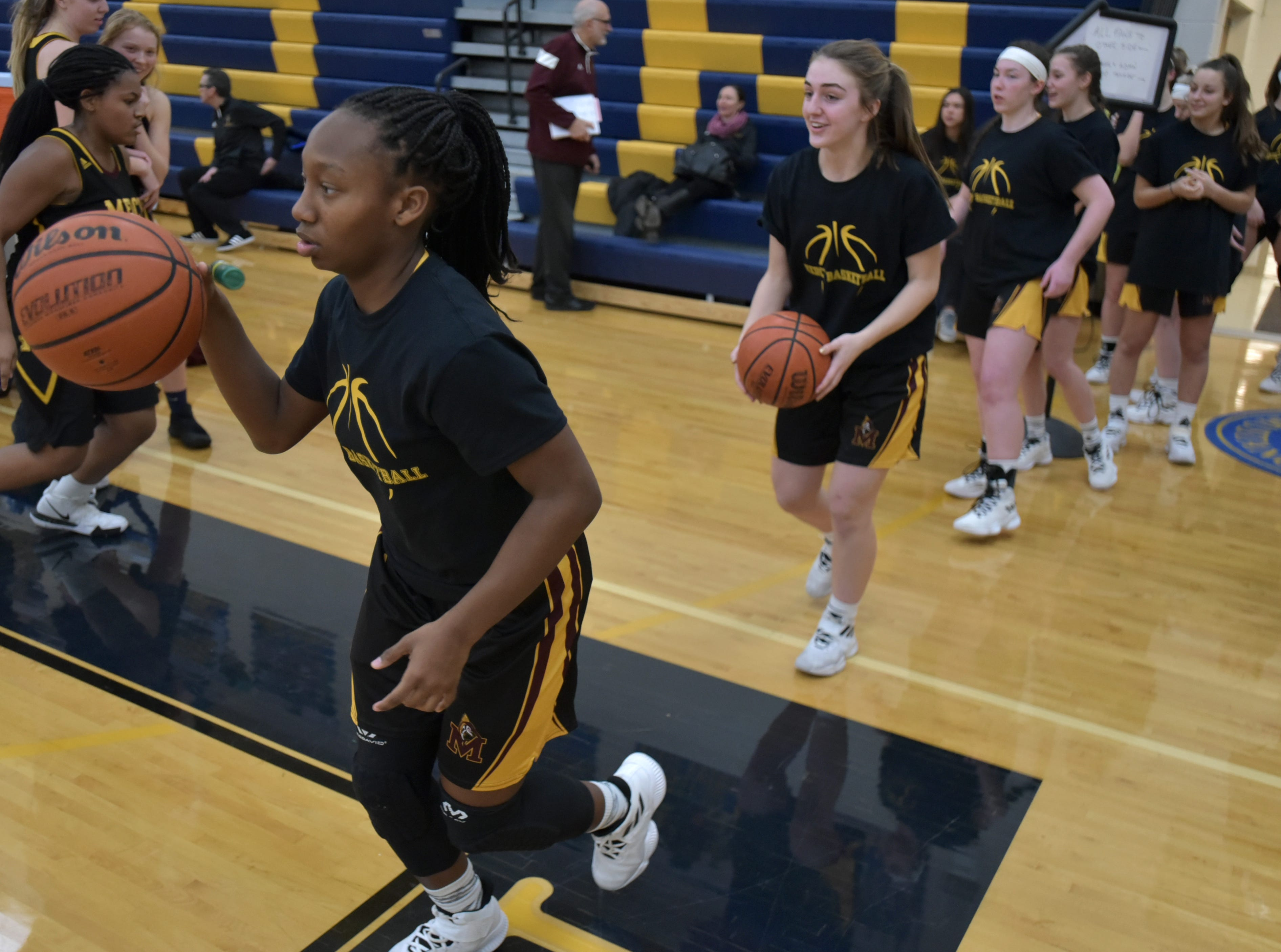 Mercy High player Daniela Piccirilli leads her teammates out on to the floor on Jan. 19.