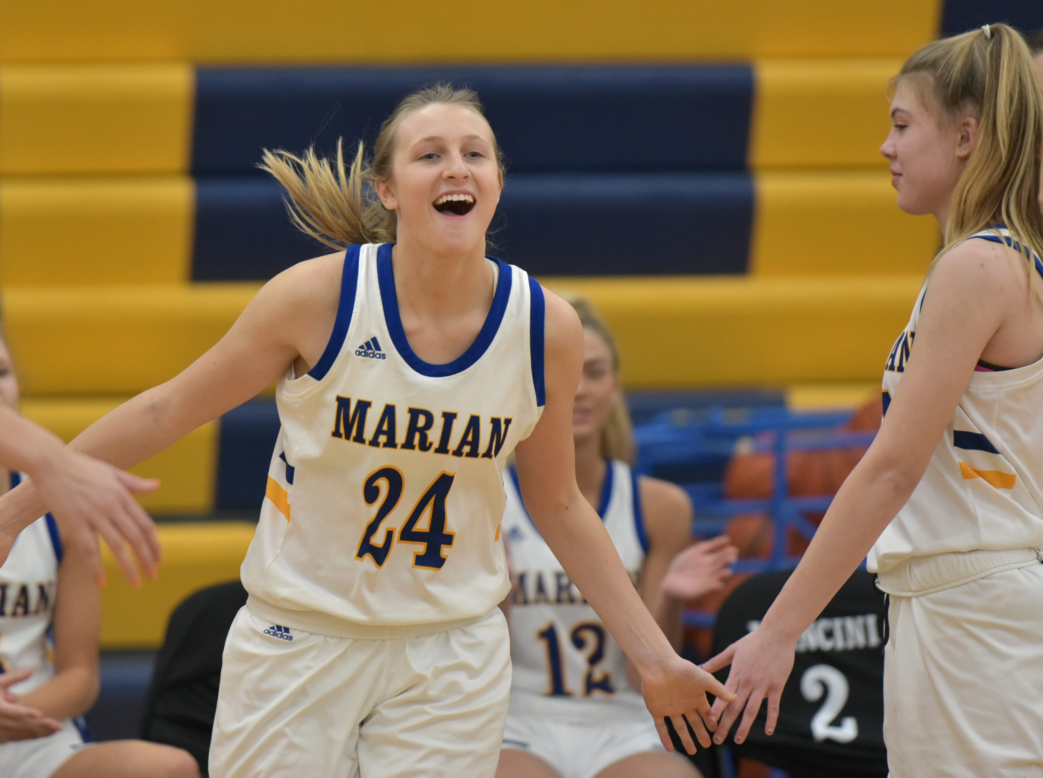 Marian High's Shannon Kennedy smiles as she's introduced during the Marlin's Jan. 19 home game.