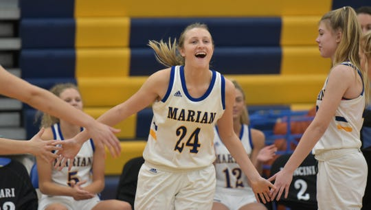 Birmingham Marian's Shannon Kennedy, introduced before the game, was all smiles as she scored a game-high 23 points in a 60-41 win over Farmington Hills Mercy.